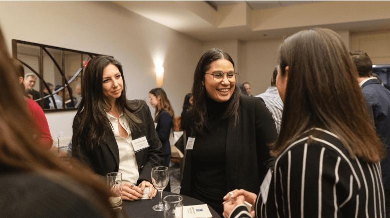 Businesswomen in an event having fun